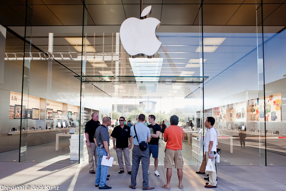 12 JUNE 2009 -- SCOTTSDALE, AZ: People wait to get into the newest Apple Store in the Phoenix area before the store's grand opening Friday. The outlet will be Arizona's largest Apple Store, occupying nearly 10,000 square feet in the Outdoor Lifestyle Center in the Scottsdale Quarter. The store, the fifth in the Phoenix area, uses a radically different design from other Apple Stores in some respects. Ceilings in the building are approximately 20 feet high, and lined with a 75-foot long skylight, reducing dependence on artificial lighting. Aiding the skylight is an all-glass front and rear, permitting visitors to see directly through the store. More than one thousand people lined to get into the store during the grand opening. Photo by Jack Kurtz