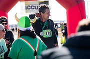 Democratic 2020 presidential candidate Beto O'Rourke, 46, looks on after finishing a St. Patrick's Day 5K race during a three day road trip across Iowa, in North Liberty, Iowa, U.S., March 16, 2019.  REUTERS/Ben Brewer