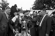 4/7/1964<br /> 7/4/1964<br /> 4 July 1964<br /> <br /> Pipe Major T.J. Keogh drinking from the cup after the Carling Pesentation, Piper John Keogh and Mr. Peter McGlynn