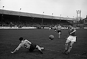 16/02/1964<br /> 02/16/1964<br /> 16 February 1964<br /> Soccer: Cork Hibernians v Drumcondra, 1st round of the F.A.I. Cup at Tolka Park, Dublin. Patrick  McGrath (Drumcondra) goes down as he foils an attack by Cork Hibernian's Johnny Kingston coming in from the right.