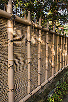 Fences and screens - kakine or kaki - are made of bamboo, wood and branches are used to define where one landscape design element cedes to another. In this way they are symbolic margins and represent the balance between nature and human intervention. Fences are also used as backdrops.  Japanese garden fences are also used to distract the eye from an unappealing background.