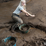 """The """"most important Neolithic cup and ring marked rock art panel in Europe"""" is being unearthed for the first time in 50 years - near a housing estate in Clydebank near Glasgow.<br /> <br /> Alison Douglas (31), a student of Archaeologist at the University helps with the excavation.<br />                        <br /> The Cochno Stone, dating back to 3000BC, and one of the best examples of Neolithic or Bronze Age cup and ring markings in Europe, is being fully excavated for the first time since it was buried in 1965 to protect it from vandalism.  Picture Robert Perry for The Herald and  Evening Times 7th Sept 2016"""