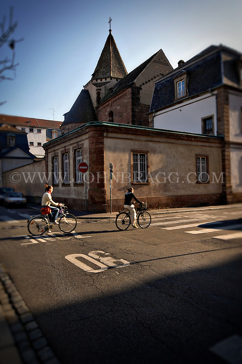 Photo of bicycle riders on the streets of Strasbourg, France