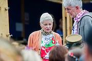 Vivienne Westwood (pictured with John Sauvin director of Greenpeace) visits the Greenpeace area which includes a huge mock uo of the Arctic Sunrise , an exhibition of images aof the imprisoned Arctic 30 and a giant animatronic polar bear - all aimed at 'Saving the Arctic'. The 2014 Glastonbury Festival, Worthy Farm, Glastonbury. 27 June 2013.