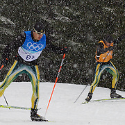Winter Olympics, Vancouver, 2010.Australian Biathlon competitor Alex Almoukov with his father and coach Nick Almoukov (right)  training in the snow on the Olympic Cross Country course at  Whistler Olympic Park  in preparation for the event at the Winter Olympics. 10th February 2010. Photo Tim Clayton