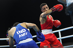 England's Galal Yafai (left) and India's Amit in the Men's Light Fly Final at Oxenford Studios during day ten of the 2018 Commonwealth Games in the Gold Coast, Australia.