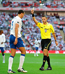 04.06.2011, Wembley Stadium, London, ENG, UEFA EURO 2012, Qualifikation, England vs Switzerland, im Bild Rio Ferdinand of England receives a yellow card from referee Damir Skomina.England v Switzerland.Euro 2012 qualifying.Wembley Stadium. London. UK. 4/6/11. EXPA Pictures © 2011, PhotoCredit: EXPA/ IPS/ Sean Ryan +++++ ATTENTION - OUT OF ENGLAND/UK and FRANCE/FR +++++