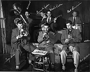 """Ackroyd 01184-4.  """"Monte Ballou. Orchestra at Rathskeller. December 26, 1948"""" This is a copy of a print that was individually autographed by each member of the band. It was intended to be a promotional photo for the band to hand out. The source of the image that was used to create the autographed print is negative #2."""