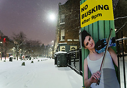 Edinburgh, Scotland, UK. 10 Feb 2021. Big freeze continues in the UK with heavy overnight and morning snow in the city. Pic;  No Busking sign in a snow covered and deserted Grassmarket. Iain Masterton/Alamy Live news