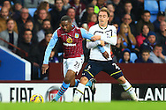 Tottenham's Christian Eriksen grips Charles N'Zogbia of Aston Villa to earn a yellow card - Aston Villa vs. Tottenham Hotspurs - Barclay's Premier League - Villa Park - Birmingham - 02/11/2014 Pic Philip Oldham/Sportimage