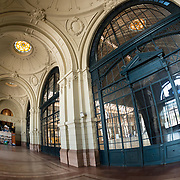 Inside the main foyer of Estacion Mapocho (Mapocho Station) in downtown Chile. Once Santiago's main train station, it was no longer used and left abandoned before being restored and is now used as a public convention and concert space. The opulent building dates to 1912.