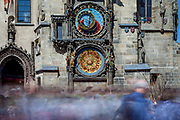 Visitors in-front of the newly renovated  Prague Astronomical Clock, or Prague Orloj which is a medieval astronomical clock located at Old-Town Square in Prague, the capital of the Czech Republic.