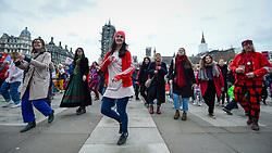 """© Licensed to London News Pictures. 22/02/2020. LONDON, UK.  Activists from Extinction Rebellion take part in an act of 'discobedience', dancing to Saturday Night Fever during """"Enough is enough, Together we march"""" in Parliament Square calling for governments to act on the negative effects of climate change.  Photo credit: Stephen Chung/LNP"""
