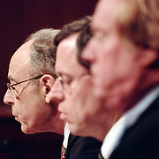 Philip Zelikow (center), Execurity Director of the 9/11 Commission, and other Commission staff members deliver a State Statement at the 9/11 Commission's Public Hearing Number 8.