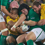 """Will Genia, Australia, is tackled by Sean O"""" Brien, Ireland, during the Australia V Ireland Pool C match during the IRB Rugby World Cup tournament. Eden Park, Auckland, New Zealand, 17th September 2011. Photo Tim Clayton..."""