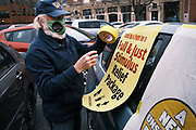 23 NOVEMBER 2020 - DES MOINES, IOWA: About 25 cars participated in Moral Monday Caravan around the Iowa State Capitol Monday. The participants were honoring the more than 2,200 Iowans who have died in the Coronavirus (SARS-CoV-2) pandemic, calling on Iowa Governor Kim Reynolds to put a strict mask mandate in place to prevent the spread of COVID-19, and for the US Congress to pass a COVID relief act.    PHOTO BY JACK KURTZ