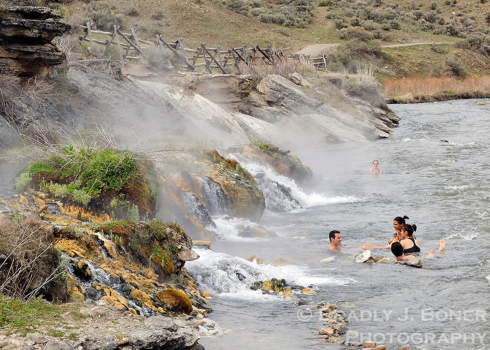 Bathers soak in the Boiling River in Yellowstone National Park just outside Gardiner, Mont. The area is located at the spot where hot runoff from Mammoth Hot Springs enters the Gardner River, cooling the water to a temperature suitable for soaking. In the early 1870s entrepaneurs built bath houses here and promoted the hot springs as a healing destination for a variety of ailments, however their claim to the area — filed only days after the establishment of Yellowstone National Park in 1872 — was denied, and the squatters were evicted from the park in the summer of 1874.