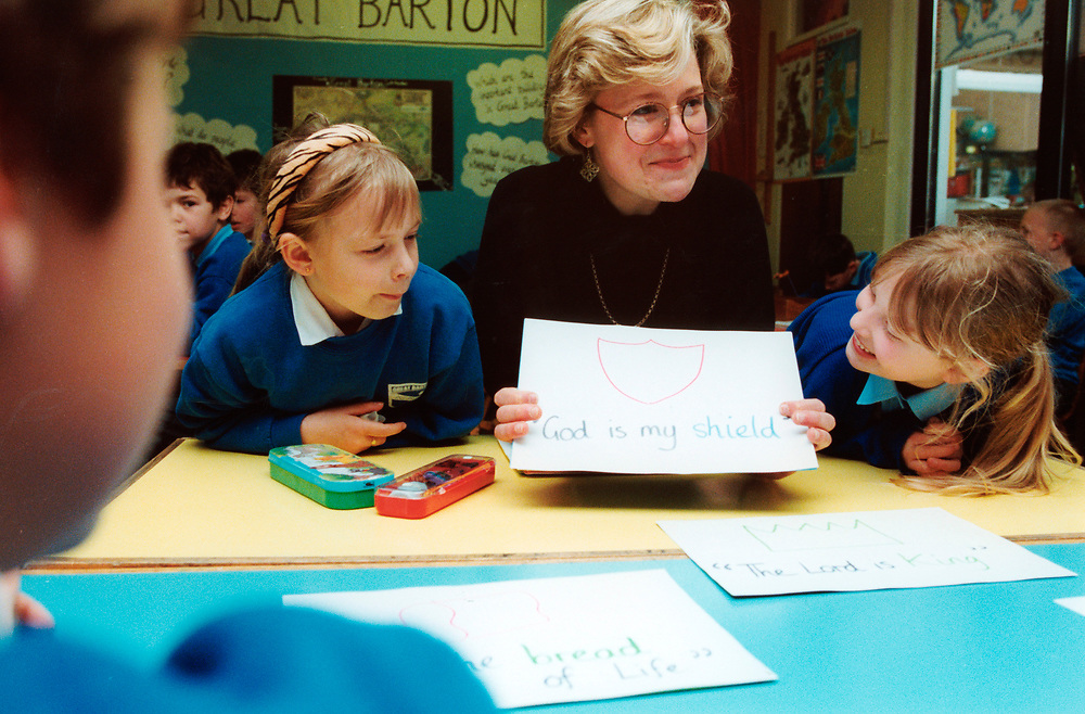 RE class in primary school, Teacher with word flash cards from the Bible; Bury St Edmonds; UK