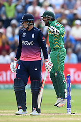 Pakistan's Sarfraz Ahmed (right) celebrates the wicket of England's Joe Root (left) during the ICC Champions Trophy, semi-final match at the Cardiff Wales Stadium.