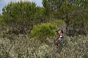 Life Lince (lynx) field technician, Rafa radio tracking a collared Iberian Lynx (Lynx pardinus)<br /> Doñana National & Natural Park. Huelva Province, Andalusia. SPAIN<br /> 1969 - Set up as a National Park<br /> 1981 - Biosphere Reserve<br /> 1982 - Wetland of International Importance, Ramsar<br /> 1985 - Special Protection Area for Birds<br /> 1994 - World Heritage Site, UNESCO.<br /> The marshlands in particular are a very important area for the migration, breeding and wintering of European and African birds. It is also an area of old cultures, traditions and human uses - most of which are still in existance.<br /> <br /> Mission: Iberian Lynx, May 2009<br /> © Pete Oxford / Wild Wonders of Europe<br /> Zaldumbide #506 y Toledo<br /> La Floresta, Quito. ECUADOR<br /> South America<br /> Tel: 593-2-2226958<br /> e-mail: pete@peteoxford.com<br /> www.peteoxford.com