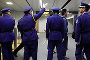 Tokyo Japan uniformed guard guides at the new Shibuya station