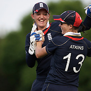 Caroline Atkins is congratulated by Sarah Taylor after taking  a spectacular catch on the boundary to dismiss New Zealand batter Aimee Mason during the match between England and New Zealand in the Super 6 stage of the ICC Women's World Cup Cricket tournament at Bankstown Oval, Sydney, Australia on March 14 2009, England won the match by 31 runs. Photo Tim Clayton