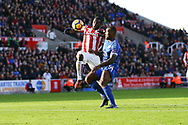 Wes Morgan of Leicester City (r) challenges  Mame Biram Diouf of Stoke City. Premier league match, Stoke City v Leicester City at the Bet365 Stadium in Stoke on Trent, Staffs on Saturday 4th November 2017.<br /> pic by Chris Stading, Andrew Orchard sports photography.