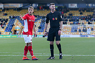 Ollie Yates Referee and Jamie Ward of Charlton Athletic (16) during the The FA Cup match between Mansfield Town and Charlton Athletic at the One Call Stadium, Mansfield, England on 11 November 2018.