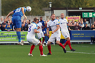AFC Wimbledon striker James Hanson (18) winning header in the box during the EFL Sky Bet League 1 match between AFC Wimbledon and Portsmouth at the Cherry Red Records Stadium, Kingston, England on 13 October 2018.