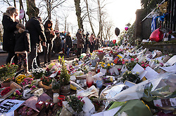 Flowers left outside the home of George Michael in Highgate, north London, as his boyfriend denied sending tweets speculating about the cause of the pop superstar's death and said his Twitter account was hacked.