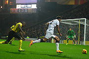 Cyrus Christie leads a late Derby attack during the Sky Bet Championship match between Watford and Derby County at Vicarage Road, Watford, England on 22 November 2014.