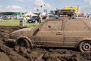 Moscow, Russia 12/07/2008..A Volkswagen is towed through the mud at the annual Autoexotica Show, a ten day festival that attracts thousands of Russian motor enthusiasts. Figures show the Russian auto market has just overtaken Germany's to become the largest in Europe, and analysts predict that within four years it will be the third largest in the world.