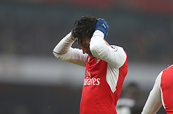 11 February 2017 Premier League Football : Arsenal v Hull City :<br /> Mesut Ozil holds his head in his hands.<br /> Photo: Mark Leech