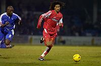 Photo: Alan Crowhurst.<br />Gillingham v Swindon Town. Coca Cola League 1. 14/01/2006. <br />Ashan Holgate (R) on the move for Swindon.