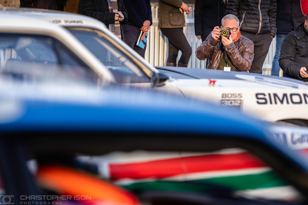 Photographer Jon Nicholson while working for the Duke of Richmond at the 77th Member's Meeting.<br /> <br /> Picture date: Saturday April 6, 2019.<br /> Photograph by Christopher Ison ©<br /> 07544044177<br /> chris@christopherison.com<br /> www.christopherison.com