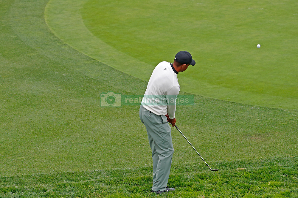 June 12, 2019 - Pebble Beach, CA, U.S. - PEBBLE BEACH, CA - JUNE 12: PGA golfer Tiger Woods plays the 17th hole during a practice round for the 2019 US Open on June 12, 2019, at Pebble Beach Golf Links in Pebble Beach, CA. (Photo by Brian Spurlock/Icon Sportswire) (Credit Image: © Brian Spurlock/Icon SMI via ZUMA Press)