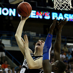 Mar 26, 2011; New Orleans, LA; Butler Bulldogs center Andrew Smith (44) shoots over Florida Gators center Vernon Macklin (32) during the first half of the semifinals of the southeast regional of the 2011 NCAA men's basketball tournament at New Orleans Arena.   Mandatory Credit: Derick E. Hingle