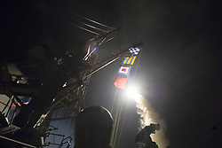 April 7, 2017 - Mediterranean Sea - In this photo released by the United States Navy, the USS Ross (DDG 71) fires a tomahawk land attack missile April 7, 2017. USS Ross, an Arleigh Burke-class guided-missile destroyer, forward-deployed to Rota, Spain, is conducting naval operations in the U.S. 6th Fleet area of operations in support of U.S. national security interests in Europe and Africa in the Mediterranean Sea. .Mandatory Credit: Robert S. Price / US Navy via CNP (Credit Image: © Robert S. Price/CNP via ZUMA Wire)