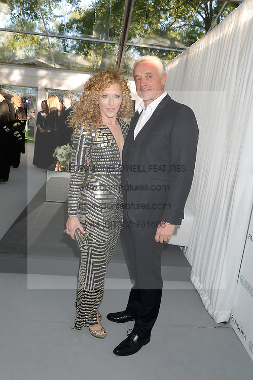 KELLY HOPPEN and JOHN GARDINER at the Glamour Women of the Year Awards in association with Pandora held in Berkeley Square Gardens, London on 4th June 2013.