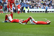 Mark Hudson, the Huddersfield Town captain and Christopher Schindler of Huddersfield Town lying on the pitch dejected after the final whistle after losing the game. EFL Skybet  championship match, Reading  v Huddersfield Town at The Madejski Stadium in Reading, Berkshire on Saturday 24th September 2016.<br /> pic by John Patrick Fletcher, Andrew Orchard sports photography.