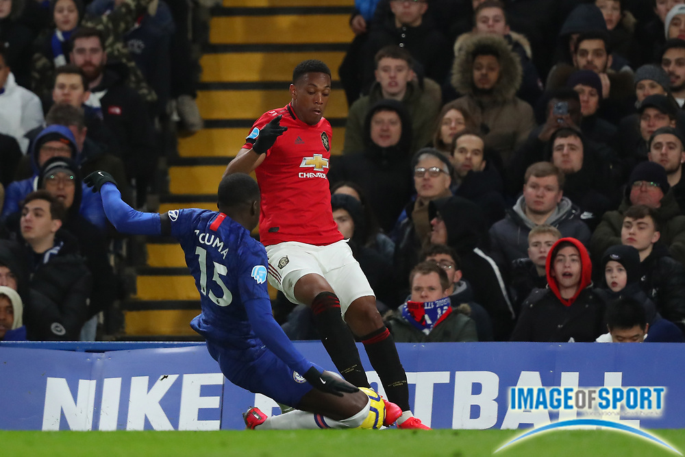 Defender Kurt Zouma of Chelsea tackles Forward Anthony Martial of Manchester United  during the English Premier League match between Chelsea and Manchester United at Stamford Bridge, Monday, Feb. 17, 2020, in London, United Kingdom. Manchester United defeated Chelsea 2-0. (Mitchell Gunn/Image of Sport)