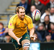 Rocky Elsom of Australia passes the ball during the Investec series international between England and Australia at Twickenham, London, on Saturday 13th November 2010. (Photo by Andrew Tobin/SLIK images)
