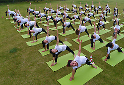 June 21, 2017 - Huai'An, Huai'an, China - Huai'an, CHINA-June 21 2017: (EDITORIAL USE ONLY. CHINA OUT)..Hundreds of people practice yoga at a park in Huai'an, east China's Jiangsu, June 21st, marking the International Yoga Day. (Credit Image: © SIPA Asia via ZUMA Wire)