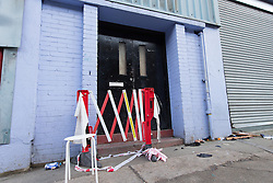 © Licensed to London News Pictures. 22/12/2013. London, UK. General view showing the entrance to Unit 10, Studio Spaces in Pennington Street, East London. Around 16 emergency vehicles attended an incident in the early hours of 22 December 2013 where a 'Santa Stamp' rave event was being held and two people were stabbed, windows were broken and objects were thrown from windows on the top floor. Photo credit : Vickie Flores/LNP