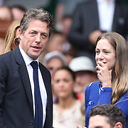 LONDON, ENGLAND - JULY 16: Hannah Bagshawe and Hugh Grantat the Mens Singles Final between Roger Federer of Switzerland and Marin Cilic of Croatia during the Wimbledon Lawn Tennis Championships at the All England Lawn Tennis and Croquet Club at Wimbledon on July 16, 2017 in London, England. (Photo by Tim Clayton/Corbis via Getty Images)