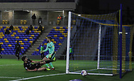 Lincoln City Defender Joe Walsh (16) jut misses during the EFL Sky Bet League 1 match between AFC Wimbledon and Lincoln City at Plough Lane, London, United Kingdom on 2 January 2021.