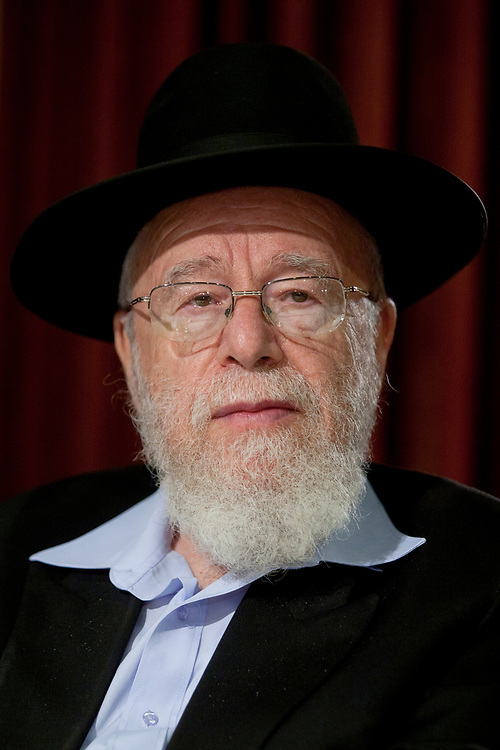"""A portrait of Rabbi Dov Lior, during a solidarity rally with Rabbis Dov Lior and Yakov Yosef at the Ramada Renaissance hotel in Jerusalem, on August 18, 2010.<br /> Rabbis Lior and Yosef refused to be investigated by Israeli police for their endorsement of the content of the book """"Torat Hamelech"""" (The King's Torah), which discusses the rules of war, and states that in certain situations, non-Jews can be killed, was co-written by Elitzur Hershkowitz and Rabbi Yitzhak Shapira of the West Bank settlement of Yitzhar. An investigation is ongoing against the author and the two Rabbis, all suspected of incitement."""
