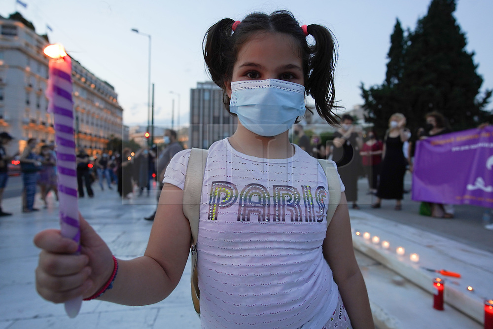 © Licensed to London News Pictures. 19/06/2021. Athens, Greece. Maria Panagiotopoulou,5, from Glyka Nera, holds a candle outside the Hellenic Parliament in Athens as she takes part in a memorial service for the memory of Caroline Crouch. Babis Anagnostopoulos confessed he killed his wife after she threatened to leave him and take their 11-month-old daughter with her following an argument. Photo credit: Ioannis Alexopoulos/LNP<br /> **Permission Granted