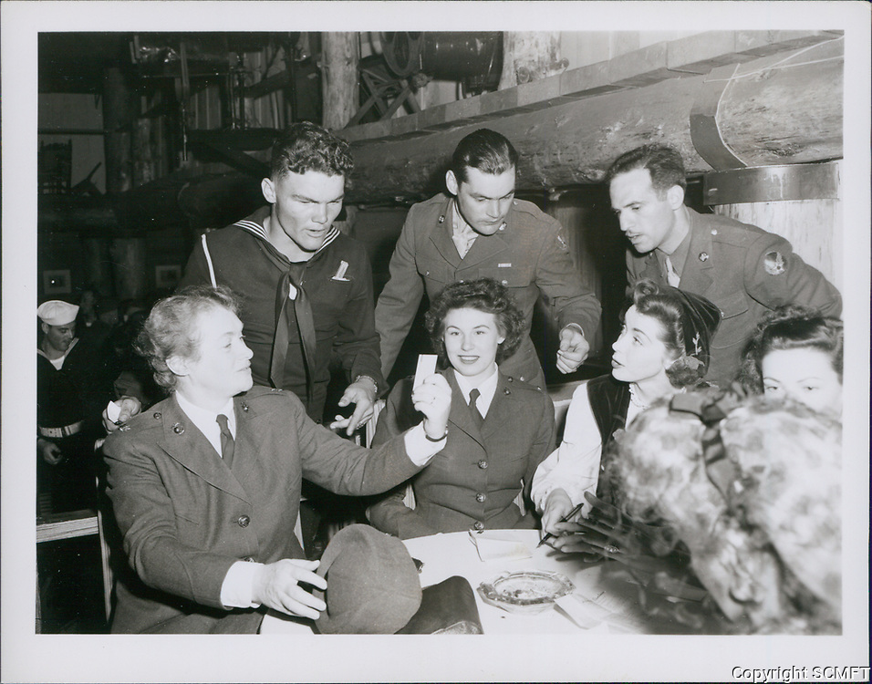 1943 Hostesses sit and chat with servicemen and women