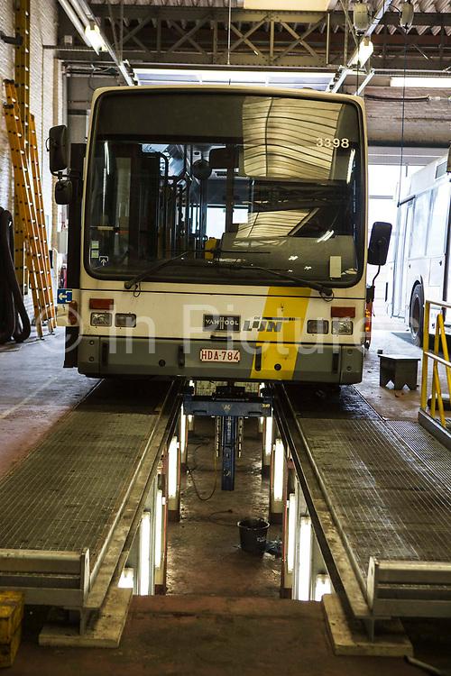 A Ghent De Lijn electric tramcar undergoing essential maintenance in the company's depot on Brusselsesteenweg in Gentbrugge, Ghent, Belgium.